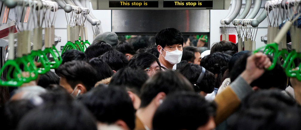 A man wearing a mask as a preventive measure against the coronavirus rides on a train in Seoul, South Korea, March 5, 2020.   REUTERS/Kim Hong-Ji     TPX IMAGES OF THE DAY - RC2FDF9DTFFT