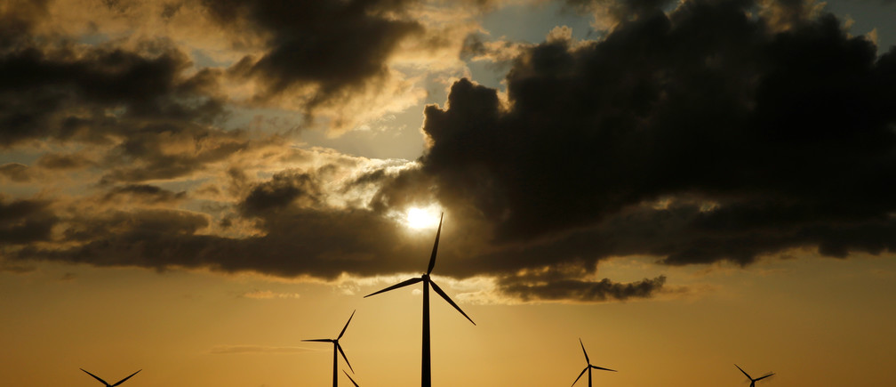 Power-generating windmill turbines are pictured during sunset at a wind park in Saint-Leger near Bapaume, France, August 18, 2019