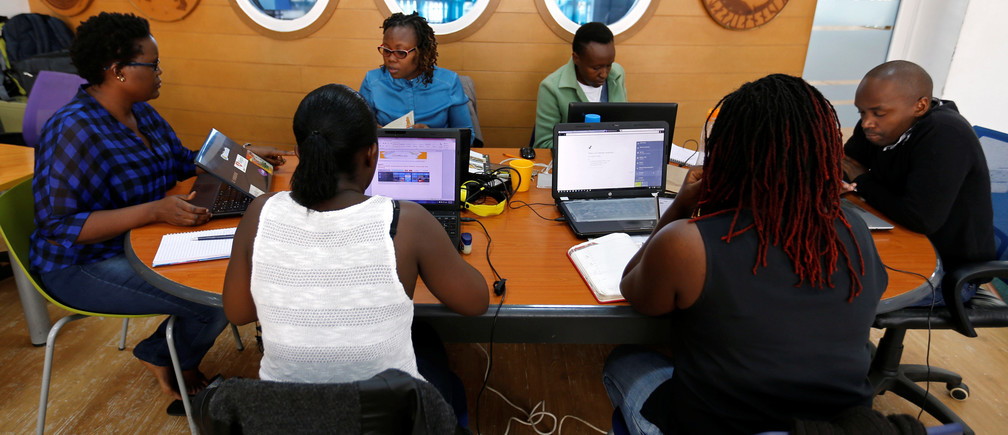 Entrepreneurs work on their projects at Nailab, a Kenyan firm that supports technology startups, behind the latest initiative, which targets entrepreneurs for their ideas on providing sex education through technology and social media in Nairobi, Kenya, July 4, 2016. REUTERS/Thomas Mukoya - D1BETNPEWNAB