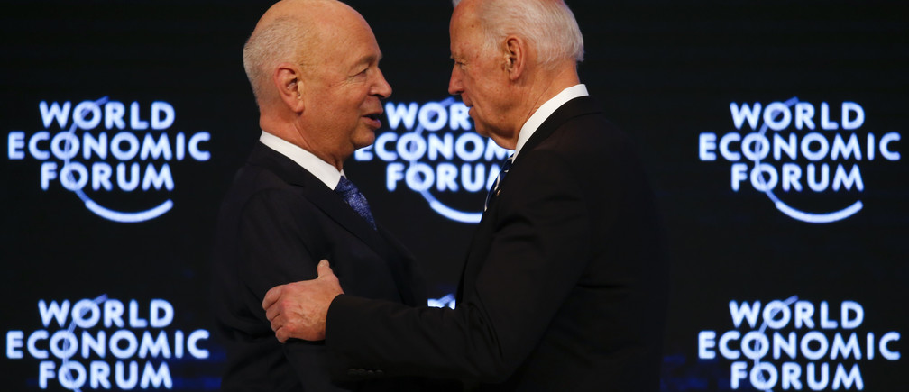 Klaus Schwab, Founder and Executive Chairman, World Economic Forum welcomes Joe Biden, Vice President of the United States at the annual meeting of the World Economic Forum (WEF) in Davos, Switzerland January 18, 2017.  REUTERS/Ruben Sprich - RTSW15C