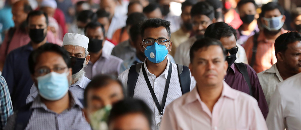 People wear masks as a protective measure after the first reported case of coronavirus in Dhaka, Bangladesh March 10, 2020. REUTERS/Mohammad Ponir Hossain - RC2YGF9XCSTX