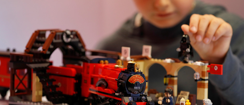Ted Wadsworth-Hill, aged 8, plays with a Lego Harry Potter Hogwarts Express train, at the launch of Hamleys top Christmas toys in London, Britain, September 26, 2018. REUTERS/Peter Nicholls - RC1C03805540