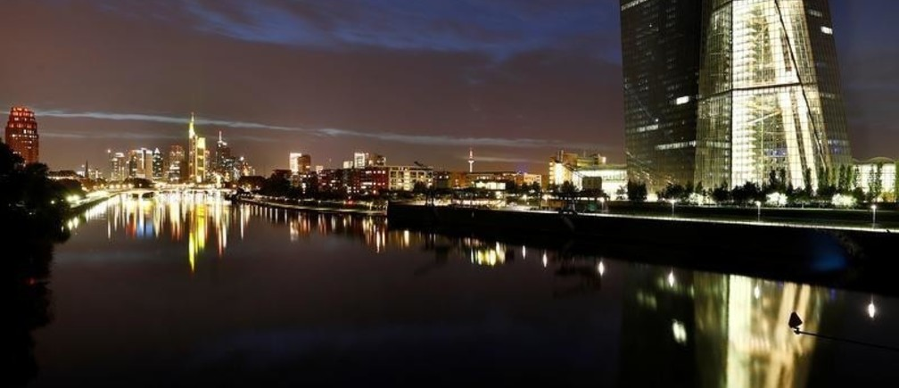 The skyline, with its characteristic banking towers and the headquarters of the European Central Bank (ECB, R), are reflected in river Main in Frankfurt, Germany, ctober 1, 2017. REUTERS/Kai Pfaffenbach - RC1F0B1CF000