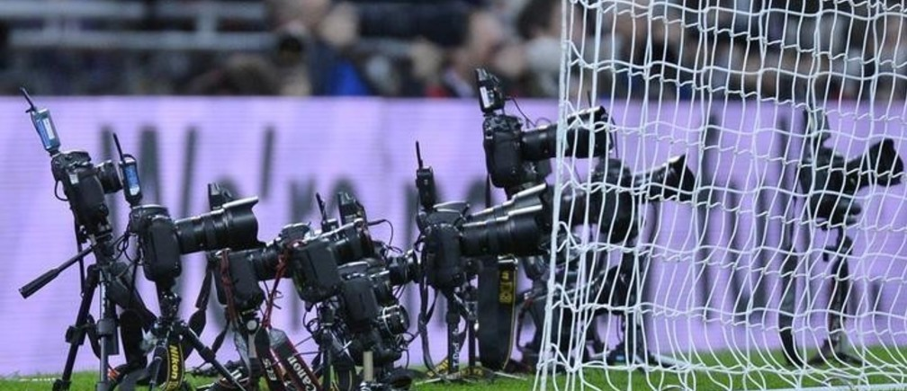 Remote cameras placed by photographers are seen behind the San Marino goal during their World Cup 2014 qualifying soccer match against England at Wembley Stadium in London October 12, 2012.    REUTERS/Toby Melville (BRITAIN  - Tags: SPORT SOCCER)