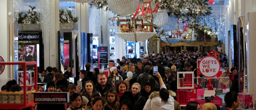 People walk through Macy's Herald Square during early opening for the Black Friday sales in Manhattan, New York, U.S., November 23, 2017.  REUTERS/Andrew Kelly - RC1A20844B00