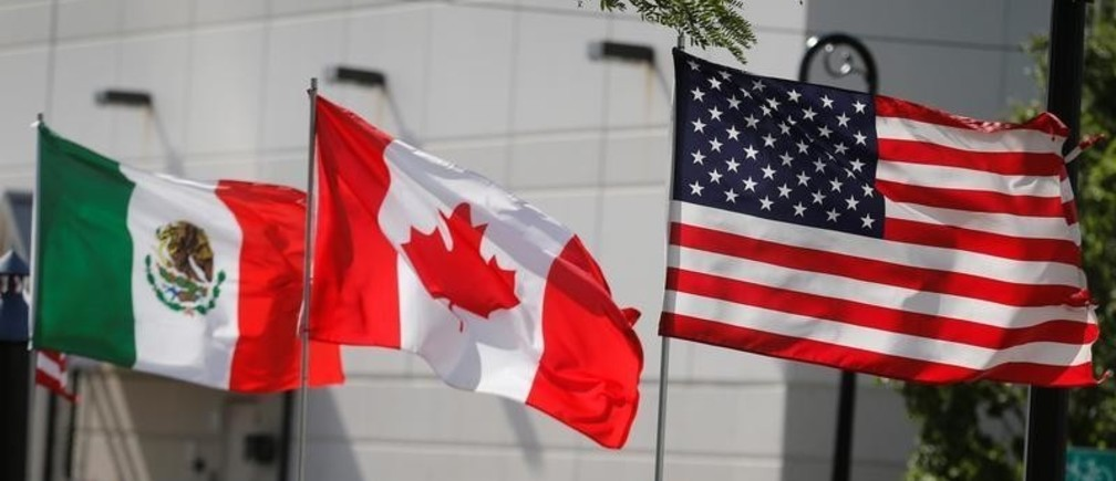 Flags of the U.S., Canada and Mexico fly next to each other in Detroit, Michigan, U.S. August 29, 2018.  REUTERS/Rebecca Cook - RC186C7DF0D0