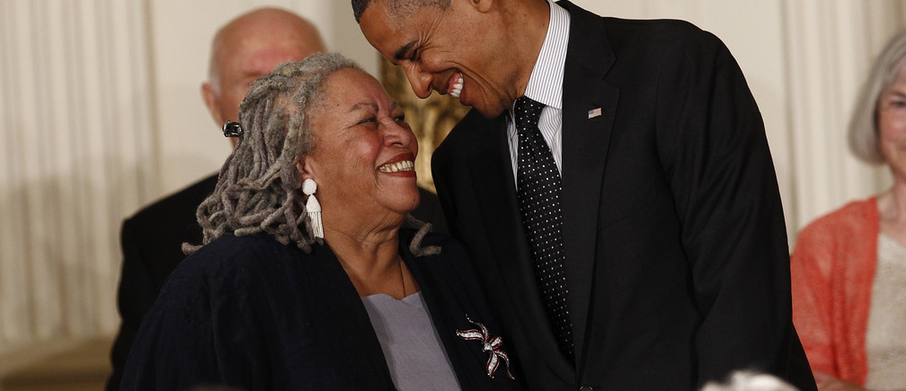 Novelist Toni Morrison smiles with U.S. President Barack Obama as he prepares to award her a 2012 Presidential Medal of Freedom during a ceremony in the East Room of the White House in Washington, May 29, 2012. REUTERS/Kevin Lamarque (UNITED STATES  - Tags: POLITICS SOCIETY PROFILE) - LM2E85T1O8001