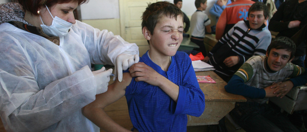 A Romanian child being vaccinated. REUTERS/Bogdan Cristel