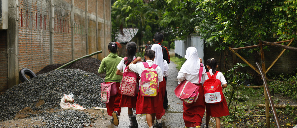 Students walk to school at Sanghiang Tanjung village in Lebak regency, Indonesia's Banten village, January 19, 2012.