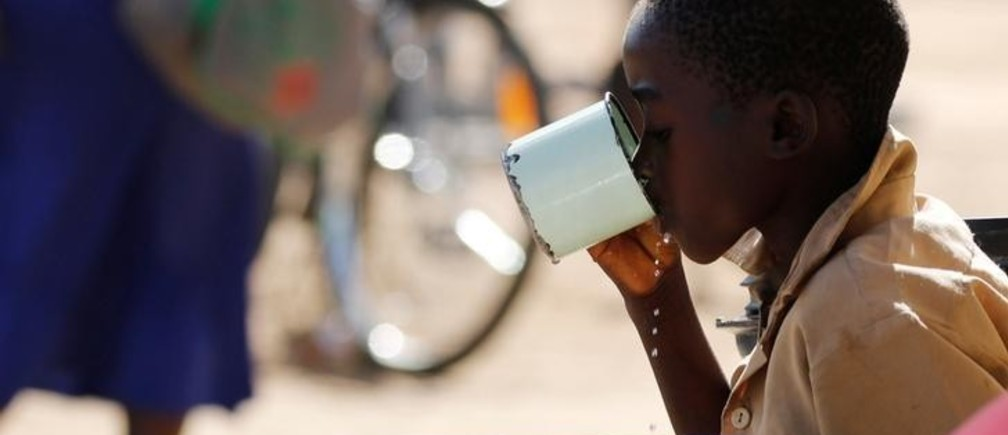 A child drinks water from a cup in drought-hit Masvingo, Zimbabwe, June 1, 2016. Picture taken June 1, 2016. REUTERS/Philimon Bulawayo
