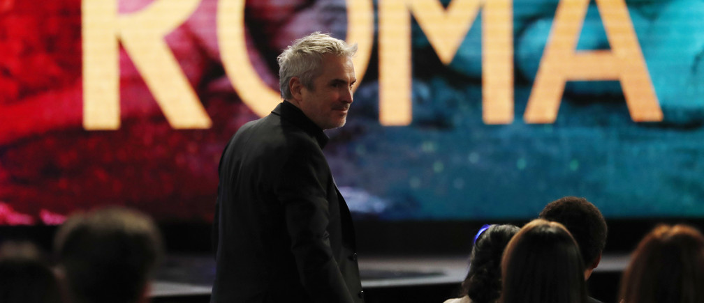 "2019 Film Independent Spirit Awards - Show - Santa Monica, California, U.S., February 23, 2019 - Alfonso Cuaron of Mexico, director of the film ""Roma,"" heads to the stage to accept the Best International Film award. REUTERS/Mario Anzuoni - HP1EF2N1T59TY"