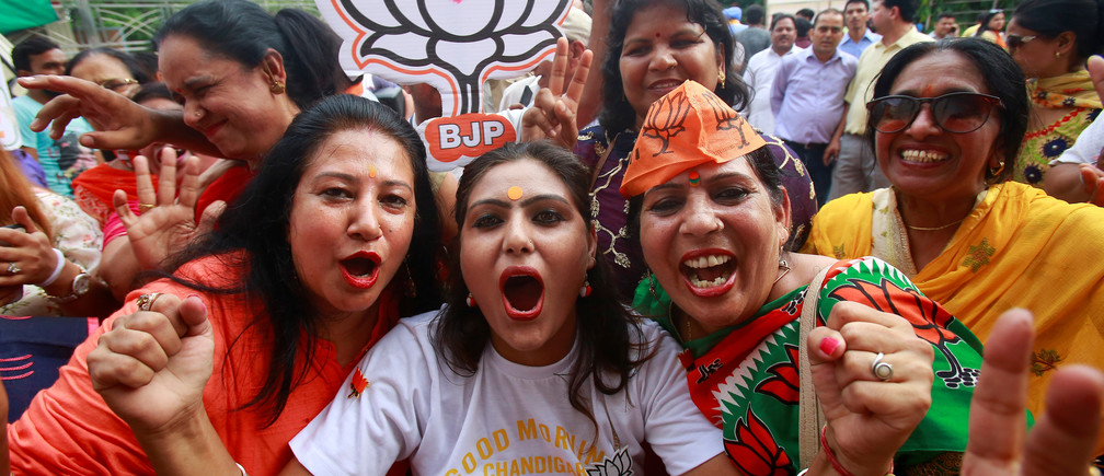 Supporters of Bharatiya Janata Party (BJP) celebrate after learning of initial poll results in Chandigarh, India, May 23, 2019. REUTERS/Ajay Verma - RC1205E41B30