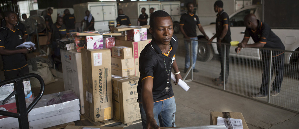 An employee of online retailer Jumia sorts packages for delivery at the company's warehouse in Lagos February 16, 2015. The growth of Africa's middle class has created demand for products that conventional retail struggles to satisfy due to a shortage of malls and grinding traffic in many cities that deters shoppers. The sector is still in its infancy. The internet's contribution to Africa's gross domestic product stood at 1.1 percent in 2013, much lower than other emerging markets. But this could rise to 10 percent, or $300 billion, by 2025, according to a report by consultants McKinsey's & Company. REUTERS/Joe Penney (NIGERIA - Tags: BUSINESS SOCIETY EMPLOYMENT) - GM1EB2G1R8301