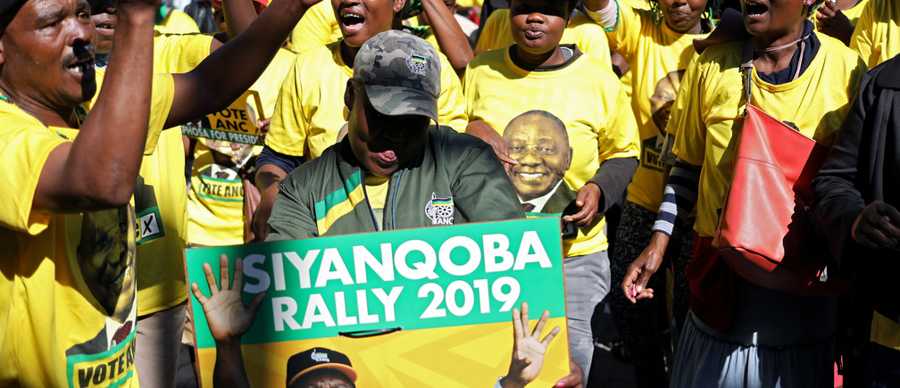 Supporters of President Cyril Ramaphosa's ruling party African National Congress (ANC) sing and dance at the party's final election rally ahead of the country's May 8 poll, in Johannesburg, South Africa, May 5, 2019. REUTERS/Siphiwe Sibeko - RC1F761176A0
