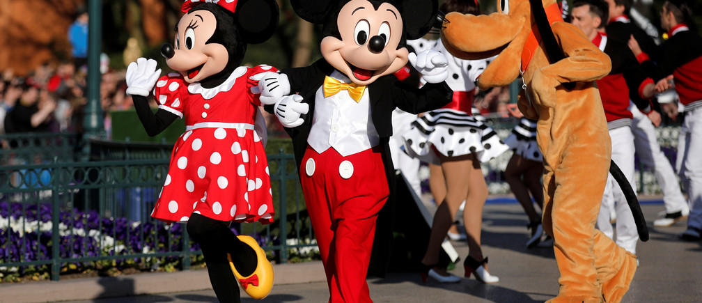 Disney characters Mickey Mouse and Minnie Mouse attend the 25th anniversary of Disneyland Paris at the park in Marne-la-Vallee, near Paris, France, April 12, 2017. REUTERS/Benoit Tessier