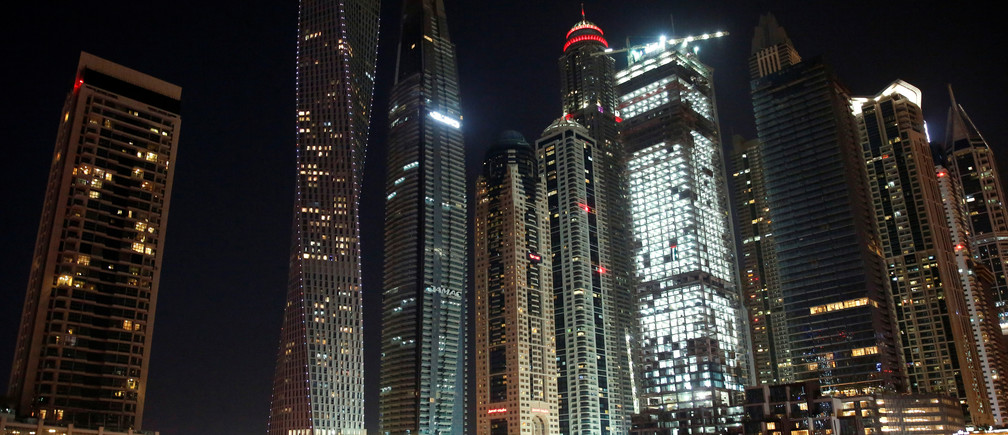 Yachts are seen at a dock at the Dubai Marina, surrounded by high towers of hotels, banks and office buildings, in Dubai, United Arab Emirates December 11, 2017. REUTERS/Amr Abdallah Dalsh - RC1D41223EB0