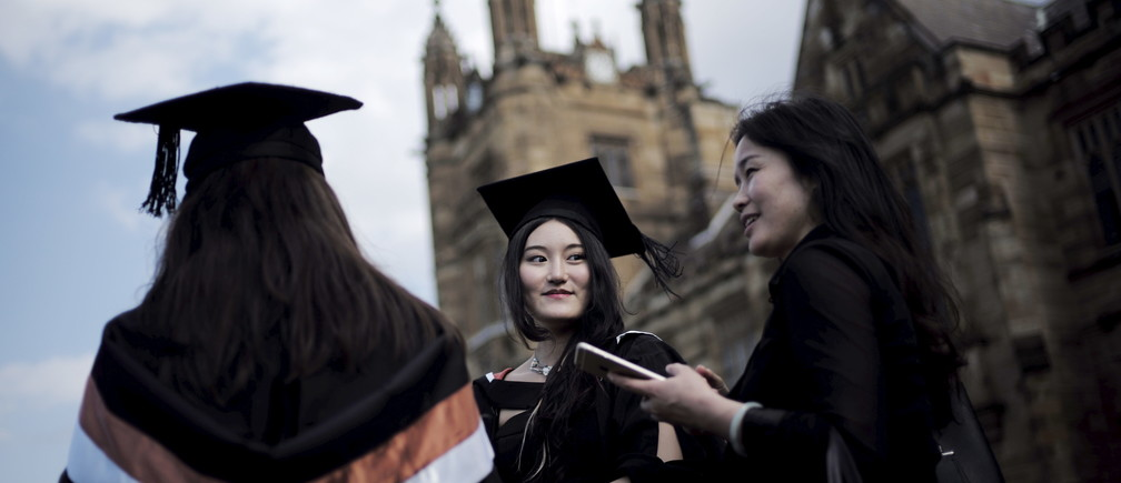 A university student wears her mortar hat following her graduation ceremony from the School of Commerce at the University of Sydney in Australia, April 22, 2016.    REUTERS/Jason Reed - RTX2B5IP