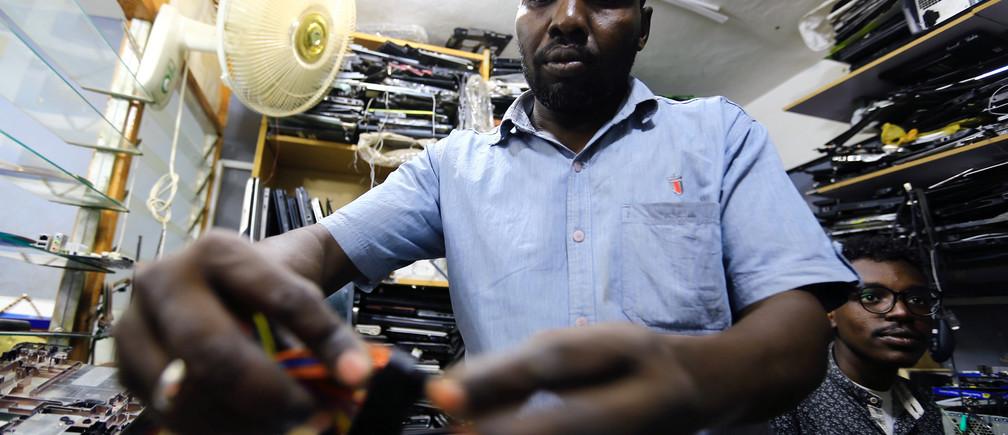 A man repairs a computer at a market in Khartoum, Sudan October 19, 2017. REUTERS/Mohamed Nureldin Abdallah