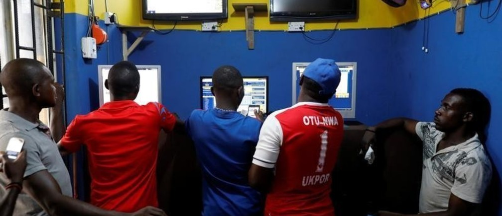 People use computer systems for online betting at a betting house in Ladipo district, in Lagos, Nigeria, June 6, 2018. Picture taken June 6, 2018.REUTERS/Akintunde Akinleye - RC1328991080
