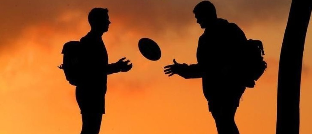 SOUTH AFRICA'S JORRIE MULLER AND DANIE COETZEE ARE SILHOUETTED IN BRISBANE DURING THE 2003 RUGBY WORLD CUP.  South Africa's Jorrie Muller (L) and Danie Coetzee are silhouetted against a Brisbane sunset after a training session, October 27, 2003. South Africa meet Samoa in their final 2003 Rugby World Cup Pool B match on Saturday. NO RIGHTS CLEARANCES OR PERMISSIONS ARE REQUIRED FOR THIS IMAGE BLIFE REUTERS/Mike Hutchings