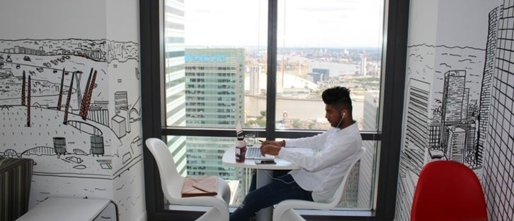 A man uses a laptop in the Level39 FinTech hub based in the One Canada Square tower of the Canary Wharf district of London, Britain, August 5, 2016. Picture taken August 5, 2016. REUTERS/Jemima Kelly