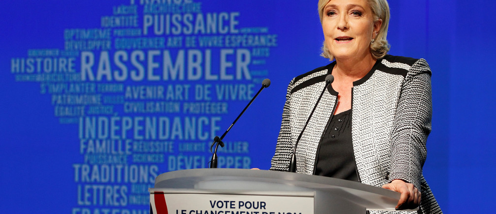French politician Marine Le Pen delivers a speech to announce the new name of the far-right National Front political party, during a national council in Bron, near Lyon, France, June 1, 2018.  REUTERS/Emmanuel Foudrot - RC1E1E0626A0
