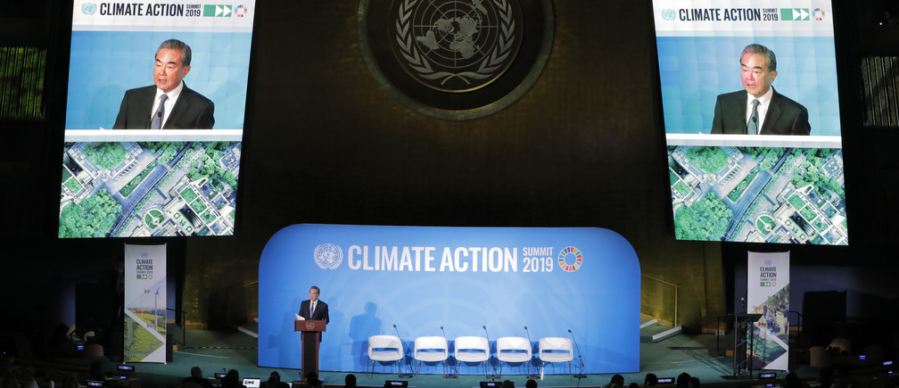 China's State Councilor and Special Representative Wang Yi speaks during the 2019 United Nations Climate Action Summit at U.N. headquarters in New York City, New York, U.S. environment renewable solar energy change transition friendly environment carbon footprint carbon emissions reduction change natural climate change global warming air pollution clean energy power renewables plastic plastics
