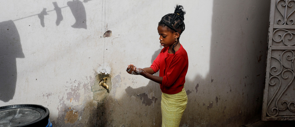 A girl washes her hands at the entrance of her parents' house in Pikine, on the outskirts of Dakar, Senegal March 9, 2020. Picture taken March 9, 2020. REUTERS/Zohra Bensemra     TPX IMAGES OF THE DAY - RC2RLF90023Y