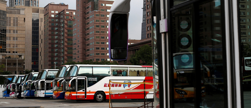 Tourist buses are parked in a row at the parking lot in Taipei, Taiwan May 6, 2016. REUTERS/Tyrone Siu  - S1BETDJDFGAF
