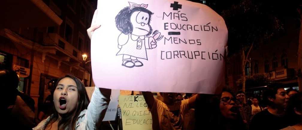 "Protesters hold a sign reading ""More education less corruption"" to protest against a plan by opposition lawmakers to oust Peru's Education Minister Jaime Saavedra in Lima, Peru, December 12, 2016"