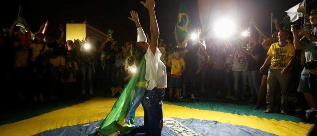 Supporters of Jair Bolsonaro, far-right lawmaker and presidential candidate of the Social Liberal Party (PSL), react after Bolsonaro wins the presidential race, in Brasilia, Brazil October 28, 2018.