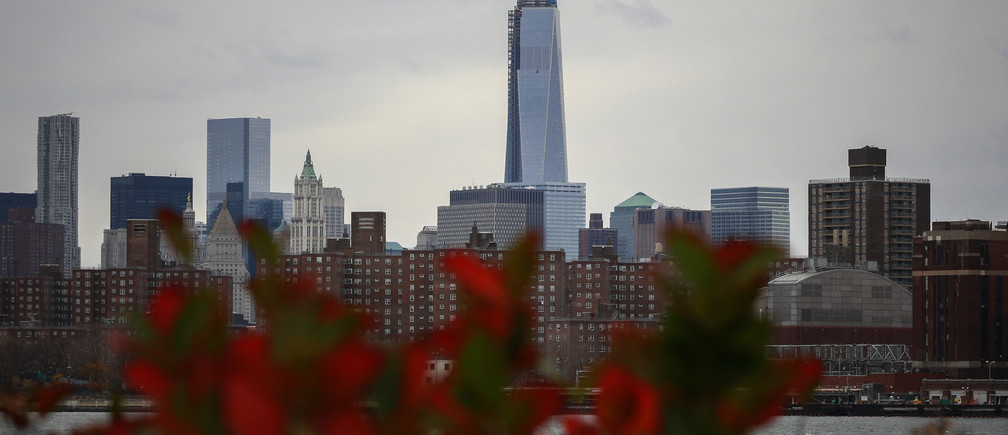 New York's One World Trade Center is seen towering over the lower Manhattan skyline November 12, 2013.