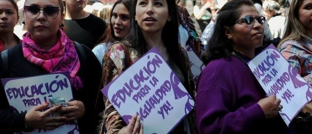 "Women participate in a rally during the Women's Day celebration in La Paz, Bolivia, March 8, 2019. The sign reads: ""Education for equality, now"". REUTERS/David Mercado - RC19DC681A80"