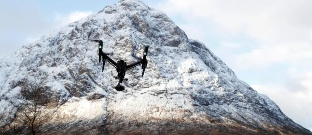 A drone flies at the foot of the mountain Buachaille Etive Mor near Ballachulish, Scotland, Britain November 30, 2017. REUTERS/Russell Cheyne