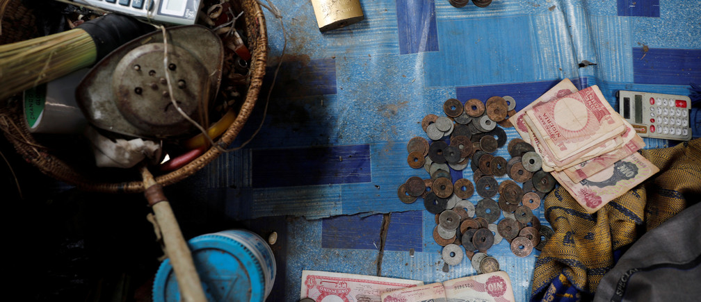 Old Nigerian currency is seen on a carpet in a local exchange shop in the old district of Nigeria's northern city of Kano, August 24, 2017.