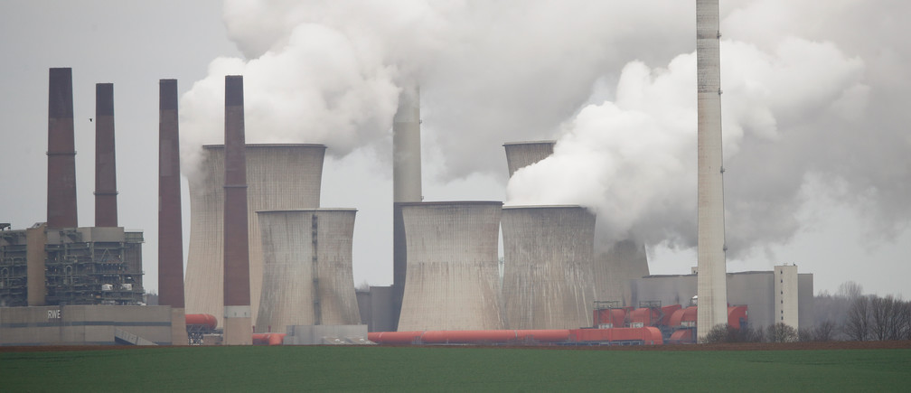 A truck drives by as steam rises from the five brown coal-fired power units of RWE, one of Europe's biggest electricity companies in Neurath, north-west of Cologne, Germany, Germany, March 12, 2019.   REUTERS/Wolfgang Rattay - RC1795859580