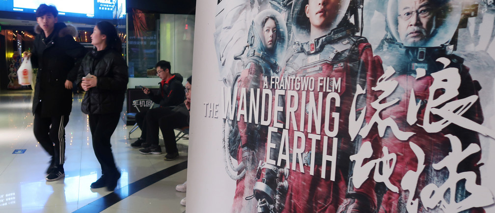 "A poster of Chinese film ""The Wandering Earth"" is pictured at a cinema in Zhengzhou, Henan province, China February 11, 2019. Picture taken February 11, 2019. REUTERS/Stringer ATTENTION EDITORS - THIS IMAGE WAS PROVIDED BY A THIRD PARTY. CHINA OUT. - RC16970F6040"