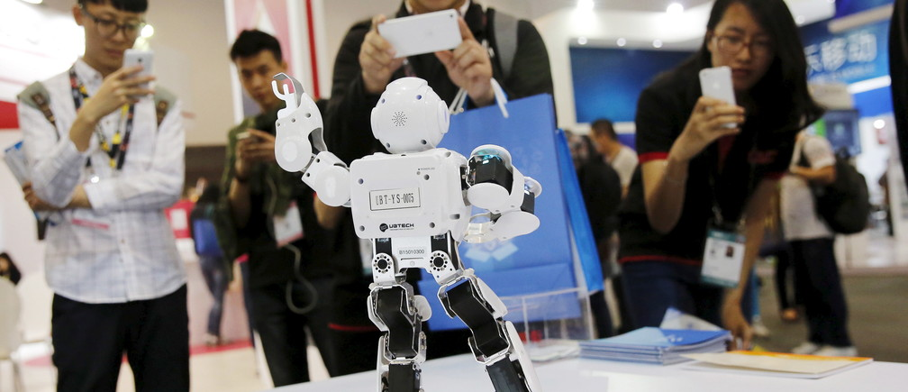 Visitors take pictures of humanoid intelligent robot Alpha developed by UBTECH at the Global Mobile Internet Conference (GMIC) 2015 in Beijing, China, April 28, 2015.