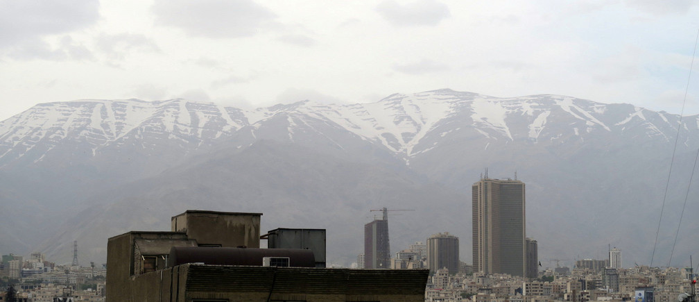 A view shows Tehran's skyline with snow-covered mountains in the background, Iran May 2, 2016. REUTERS/Marius Bosch - S1BETBTDEMAA