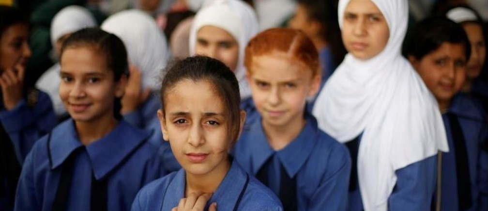 Refugee schoolchildren attend an official ceremony to return to school at one of the UNRWA schools at a Palestinian refugee camp al Wehdat, in Amman, Jordan, September 2, 2018. REUTERS/Muhammad Hamed - RC182F560080