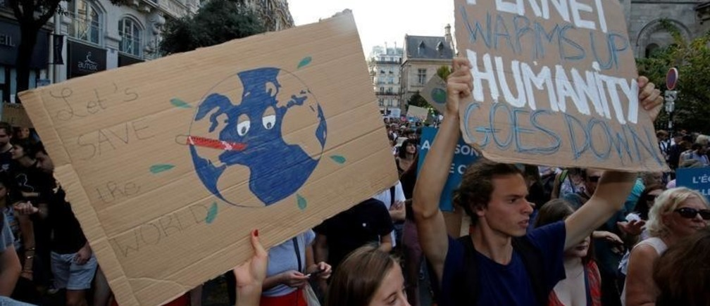 Protesters march to urge politicians to act against climate change in Paris, France, October 13, 2018.