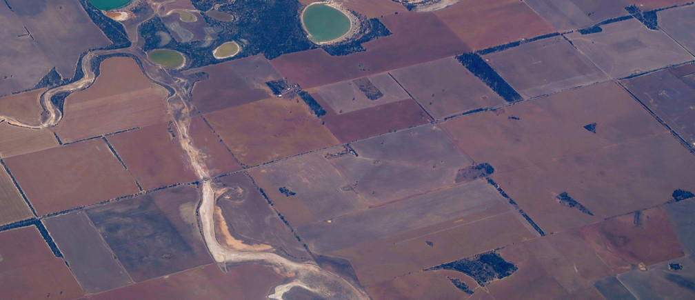 Salt lakes can be seen near a river and small dams in a drought-effected farmland area located east of the city of Perth in Australia November 8, 2016. Picture taken November 8, 2016.    REUTERS/David Gray    - RTST1X2