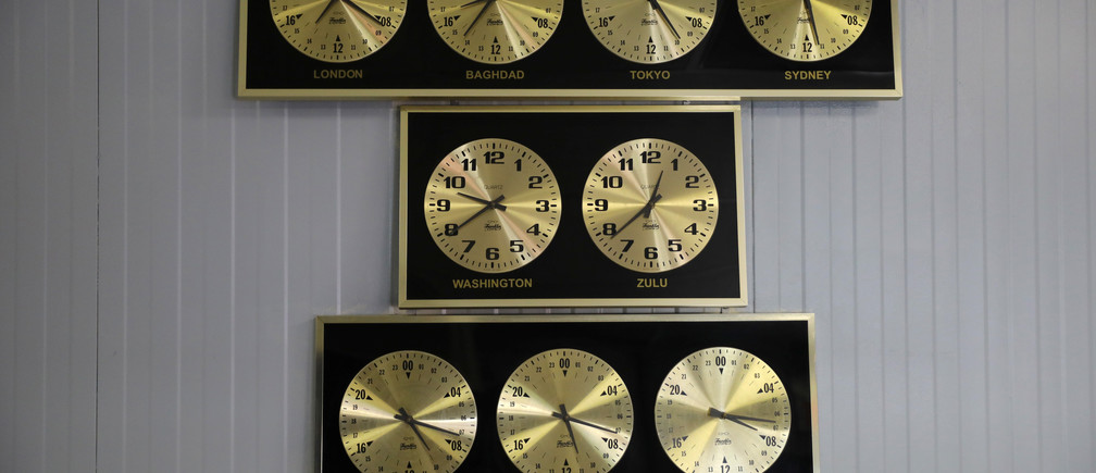 """Clocks showing time in different capitals of the world hang at the U.S. Naval Base in Guantanamo Bay, Cuba, June 3, 2017. REUTERS/Carlos Barria         SEARCH """"GUANTANAMO COMBO"""" FOR THIS STORY. SEARCH """"WIDER IMAGE"""" FOR ALL STORIES. - RC1C30DBC9D0"""