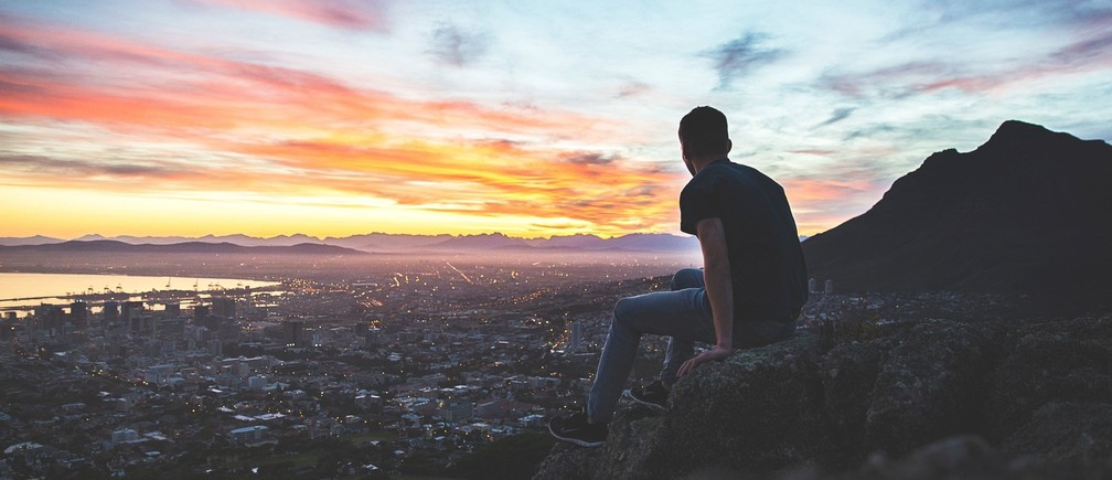Man watching Cape Town sunset