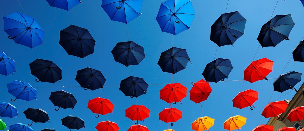 Colourful umbrellas decorate Dorner Platz (Dorner square) in Vienna, Austria September 1, 2016. REUTERS/Leonhard Foeger     TPX IMAGES OF THE DAY      - RTX2NRH9