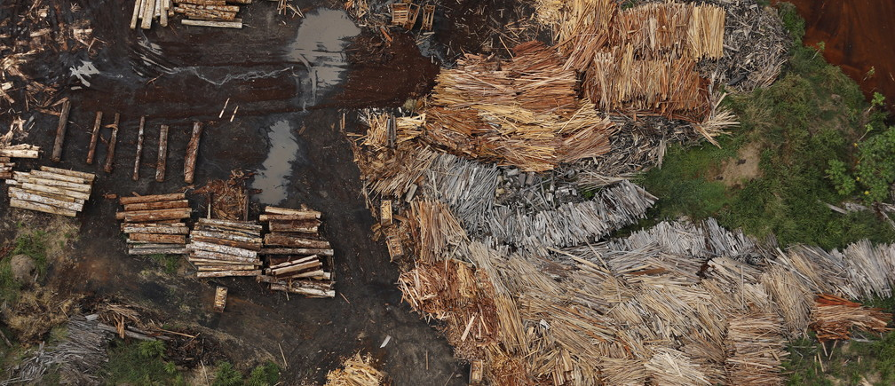 "Sawmills that process illegally logged trees from the Amazon rainforest are seen near Rio Pardo, in the district of Porto Velho, Rondonia State, Brazil, September 3, 2015. The town of Rio Pardo, a settlement of about 4,000 people in the Amazon rainforest, rises where only jungle stood less than a quarter of a century ago. Loggers first cleared the forest followed by ranchers and farmers, then small merchants and prospectors. Brazil's government has stated a goal of eliminating illegal deforestation, but enforcing the law in remote corners like Rio Pardo is far from easy. REUTERS/Nacho DocePICTURE 5 OF 40 FOR WIDER IMAGE STORY ""EARTHPRINTS: RIO PARDO"" SEARCH""EARTHPRINTS PARDO"" FOR ALL IMAGES   - RTX1UUUG"