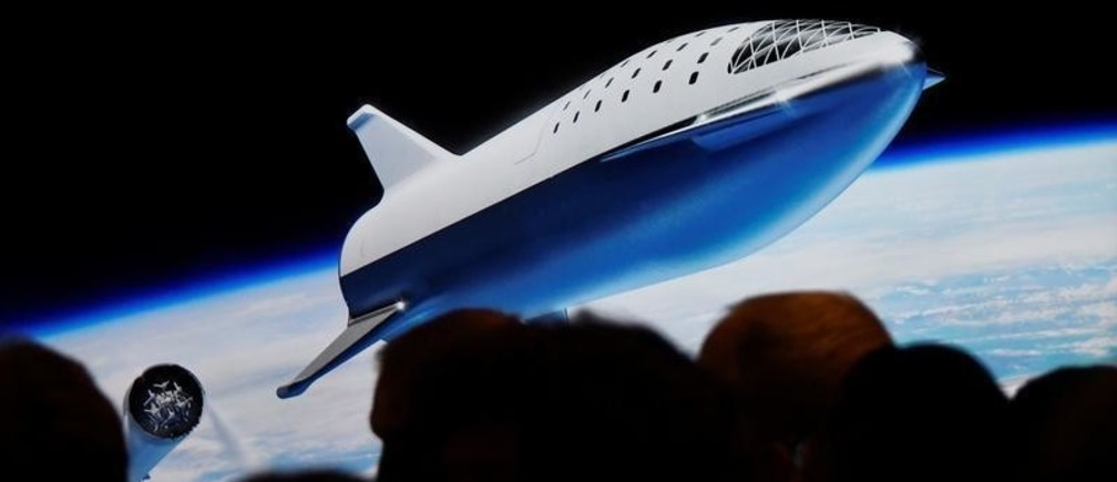 SpaceX CEO Elon Musk shows how the new BFR works during a press conference announcing the world's first private passenger scheduled to fly around the Moon aboard SpaceX's BFR launch vehicle, at the company's headquarters in Hawthorne, California, U.S. September 17, 2018. REUTERS/Gene Blevins - RC19D89B4790