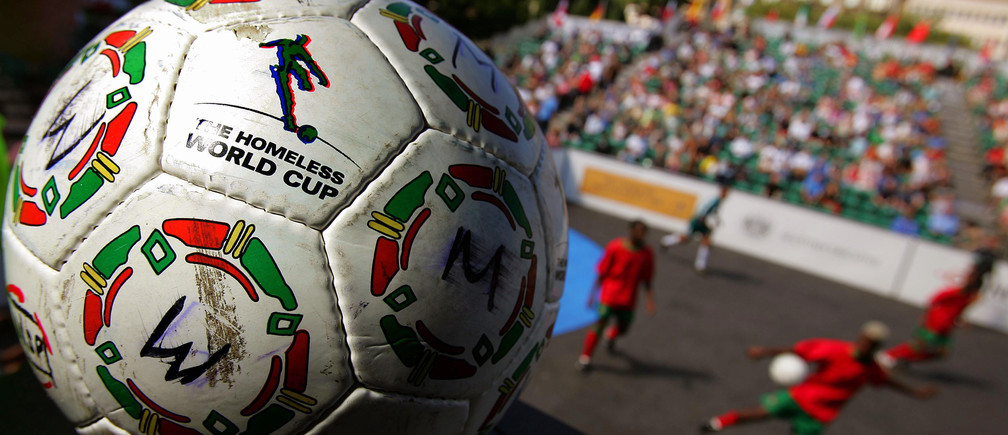 A soccer ball is seen as teams from Portugal and Russia play during the Homeless Soccer World Cup in Edinburgh, Scotland July 23, 2005.