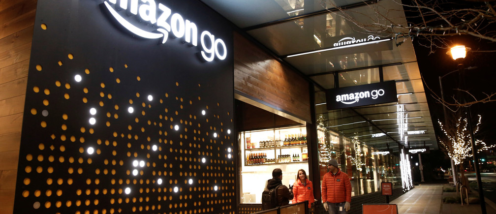 Amazon employees are pictured outside the Amazon Go brick-and-mortar grocery store without lines or checkout counters, in Seattle Washington, U.S. December 5, 2016. REUTERS/Jason Redmond - RTSUU2B
