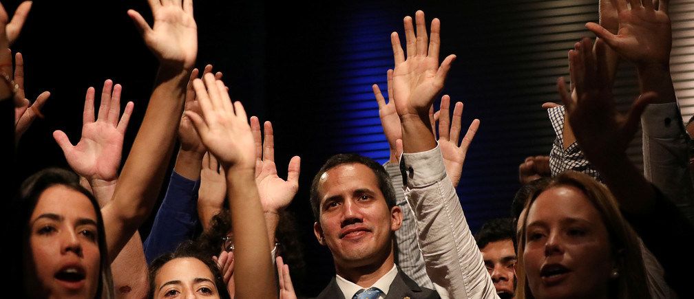 Venezuelan opposition leader Juan Guaido, who many nations have recognized as the country's rightful interim ruler, is seen with students in Caracas, Venezuela February 11, 2019. REUTERS/Andres Martinez Casares - RC1A70BEC4F0